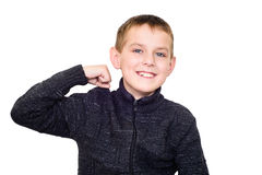 Close up portrait of strong smiling boy showing muscles. Isolated on white Royalty Free Stock Photos
