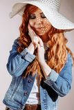 Redhead woman wearing hat on white background royalty free stock image