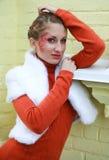 Close-up portrait stylish girl in orange Royalty Free Stock Photo