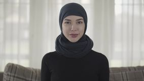 Close up portrait of successful confident young muslim business woman looking at camera smiling happy wearing stock video