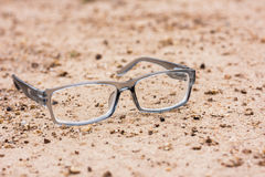 Close-up portrait sunglasses dry cracked earth. Stock Photos