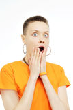 Close-up portrait of surprised beautiful girl holding her head in amazement and open-mouthed. royalty free stock image