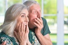 Surprised  senior couple. Close-up portrait of a surprised  senior couple at home Stock Image