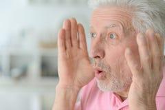 Close up portrait of surprised senior man Stock Photos