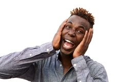 Close up surprised young african man with hands on face over white background Stock Photo