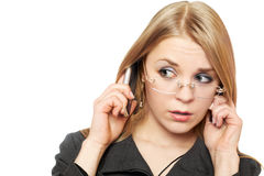 Close-up portrait of surprised young blonde. With two phones royalty free stock images