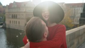 Close up portrait of Sweet couple have romantic date while honeymoon trip in old european town. Young lovers kissing and