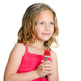 Close up portrait of sweet girl with candy rose. Stock Image