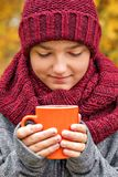 Close-up portrait of a teenage boy with closed eyes guessing a Christmas wish over a morning cup of warm tea coffee Royalty Free Stock Image