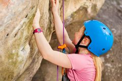 Young rock climber training in the mountains royalty free stock photography