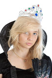 Close-up portrait of teenager princess girl. In black velvet dress and crown Stock Photos