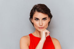 Close up portrait of tender young woman touching her face Royalty Free Stock Photography