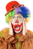 Close-up portrait of a terrified clown Stock Images