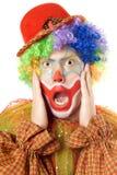 Close-up portrait of a terrified clown Stock Images