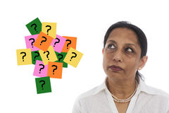 Close-up portrait of a thinking businesswoman with question mark sign Royalty Free Stock Image