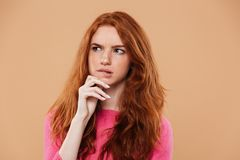 Close up portrait of a thoughtful young redhead girl Stock Photo