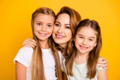 Close-up portrait of three nice cute adorable attractive healthy cheerful caucasian people cuddling mum mommy isolated royalty free stock images