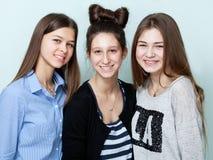 Close up portrait of three teenage girls smiling Stock Photos
