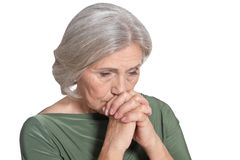 Close up portrait of tired senior woman on white background royalty free stock images