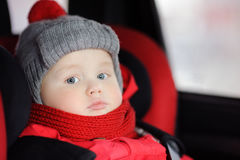 Close up portrait of toddler boy sitting in car seat Stock Photography