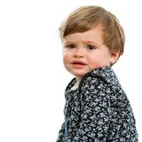 Sweet toddler with confused face expresssion. Stock Image