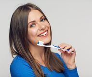 Close up portrait of toothy smiling woman. Holding toothy brush Royalty Free Stock Photo