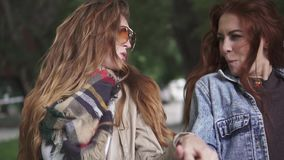 Close-up portrait of two crazy red-haired girls. Girlfriends have fun, laugh and frolic. slow motion stock video