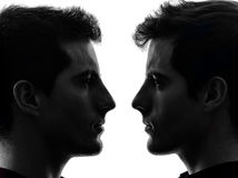 Close up portrait two  men twin brother friends silhouette Royalty Free Stock Images