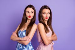 Close up portrait two people amazing beautiful she her lady classy chic had fight not speak tell talk each other offense. Wear pretty colorful dresses isolated stock images