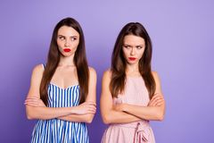 Close up portrait two people amazing beautiful she her lady classy chic had fight not speak tell talk each other offense. Wear pretty colorful dresses isolated royalty free stock photography
