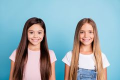 Close-up portrait of two people nice-looking sweet tender attractive beautiful cheerful straight-haired girls siblings royalty free stock images