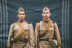 Close up portrait of two unidentified re-enactors dressed as Russian Soviet Infantry Soldiers Of World War II Royalty Free Stock Photography