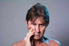 Close-up portrait of an unhappy man with a naked torso Royalty Free Stock Photo