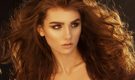 Close up portrait of very beautiful woman with volume healthy cu Royalty Free Stock Image
