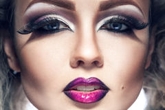 Close up portrait of voluptuous young adult girl with make up an. D healthy skin in studio Royalty Free Stock Photos
