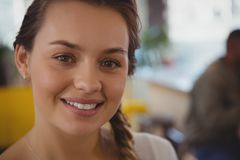 Close-up portrait of waitress. At cafe Stock Image