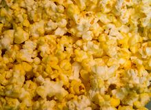 Close up of golden yellow buttered popped corn texture and details Stock Images