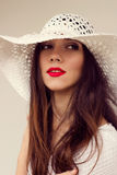 Close-up portrait. White straw hat. Sensual red lips. Boho style stock photography