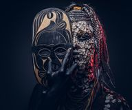 Close-up portrait of a witch from the indigenous African tribe, wearing traditional costume. Make-up concept. stock photos
