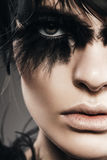 Close up portrait of woman with black feathers on eye Stock Photos