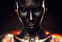 Close-up portrait of woman in black paint Royalty Free Stock Photo