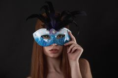 Close up portrait of woman in blue mask Royalty Free Stock Images