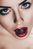 Close up portrait of woman with chrome bead Royalty Free Stock Photography