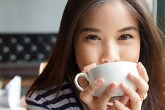 Close up portrait of woman drinking coffee Royalty Free Stock Image