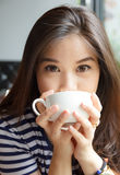 Close up portrait of woman drinking coffee Stock Photography