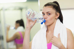 Close up portrait of a woman drinking water in gym Royalty Free Stock Image