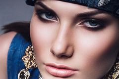 Close up portrait of woman with golden earrings Royalty Free Stock Photo