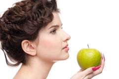 Close up portrait of woman with green apple. Stock Photos