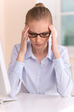 Close up portrait of woman with headache at office. Royalty Free Stock Photo