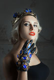 Close-up portrait of a woman with jewelry. Stock Photo